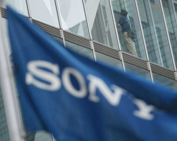 Sony Corp's headquarters is pictured past a flag bearing the company's logo in Tokyo.