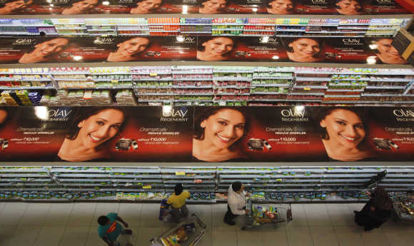 People push trolleys down the aisles as they shop at a department store in Mumbai.