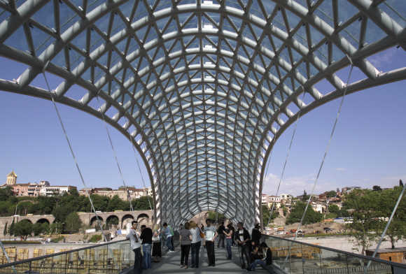 People enjoy the view from a foot bridge in the historical part of Tbilisi.