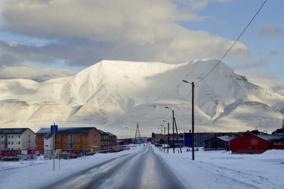 Town of Longyearbyen with the Hiortfjellet mountain in the background is seen in winter light in Svalbard, Norway.