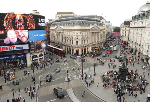 Piccadilly Circus at rush hour in central London.