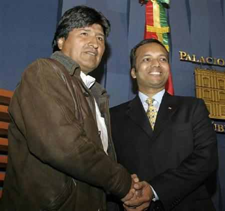 Bolivia's President Evo Morales (L) shakes hands with Naveen Jindal