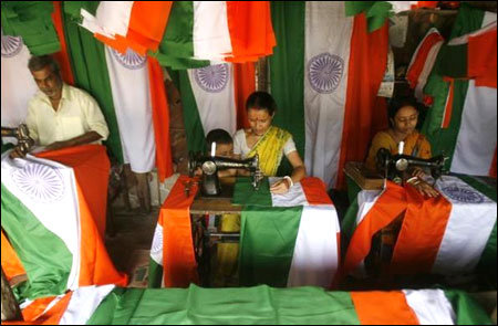 Workers stitch Indian national flags at a workshop in Siliguri.