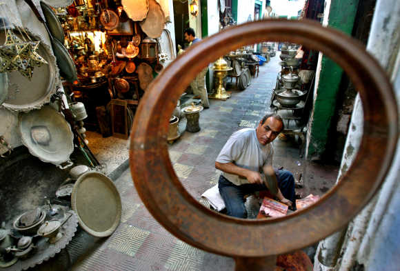 A man works at his shop in an old market of Tripoli, Libya.