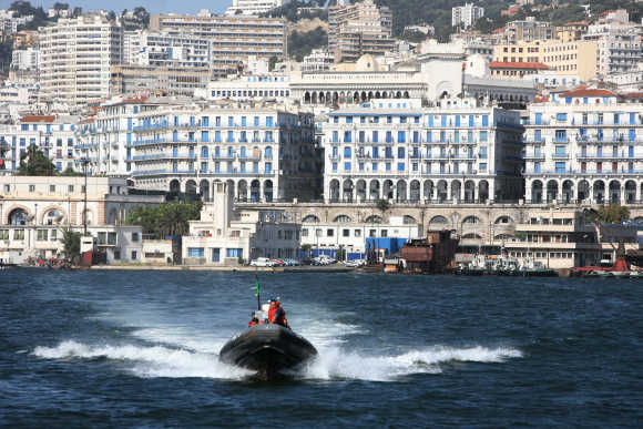 Algerian coastguards cross the bay of the Mediterranean port of Algiers.