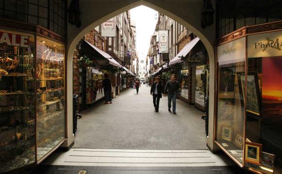 Shoppers stroll through a central Perth arcade.