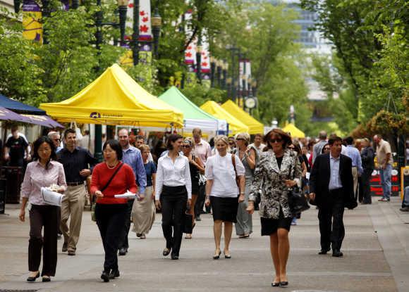 People walk down Stephen Avenue Walk in the heart of downtown Calgary.