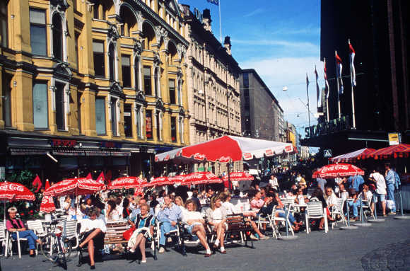 A cafe in the square of the Three Blacksmiths in Helsinki, Finland.