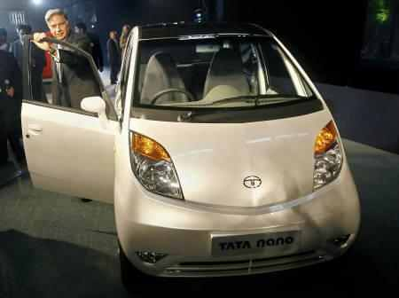 Ratan Tata with a Nano car.