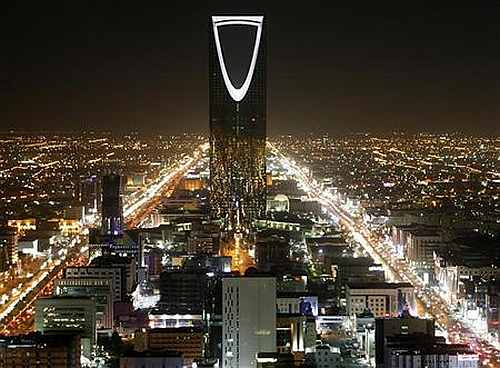 The Kingdom Tower stands in the night in Riyadh, Saudi Arabia