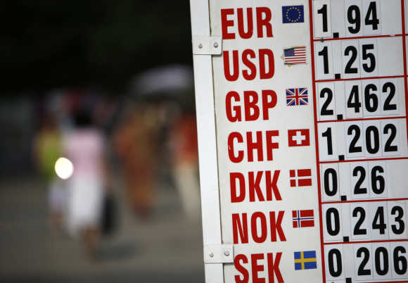 A board showing foreign currency exchange rates is displayed in Varna, 450km northeast of Bulgarian capital Sofia.