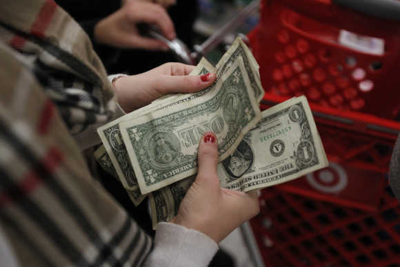 A customer counts her money in Torrington, Connecticut, United States.