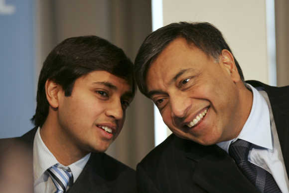 Lakshmi Mittal, right, with his son Aditya Mittal, left, in Paris.