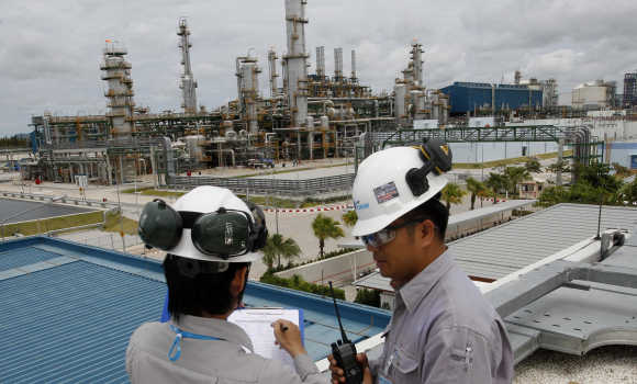 Technicians work at a Thailand's PTT Chemical complex at the Map Ta Phut industrial estate in Rayong.