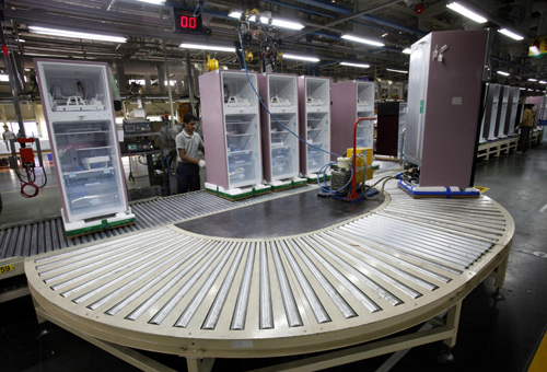A worker at LG Electronics India Pvt Ltd. assembles refrigerators inside a factory at Greater Noida in Uttar Pradesh.