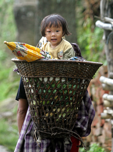 An Indian woman carries her daughter in Khonoma village, on the outskirts of Kohima.