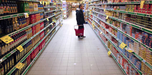 A man checks for prices in a supermarket in Rome.
