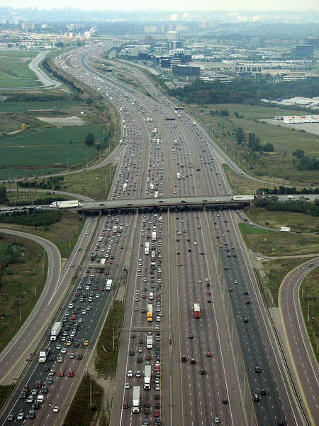 A view of the 18-lane wide Highway 401 south of Toronto Pearson International Airport in Mississauga, Ontario.