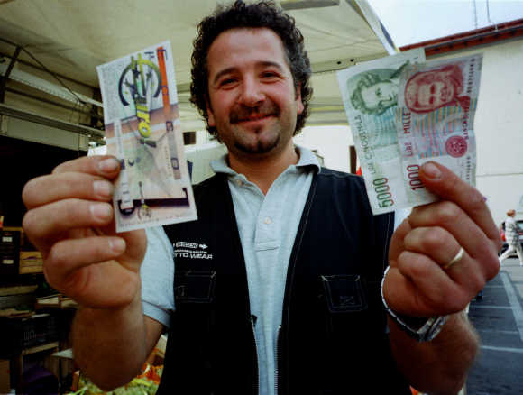 how the euro was born Belgian graphist alain billiet, who designed the euro sign before the launch of the single currency in 1999, displays his creation in brussels, jan 10, 2002.
