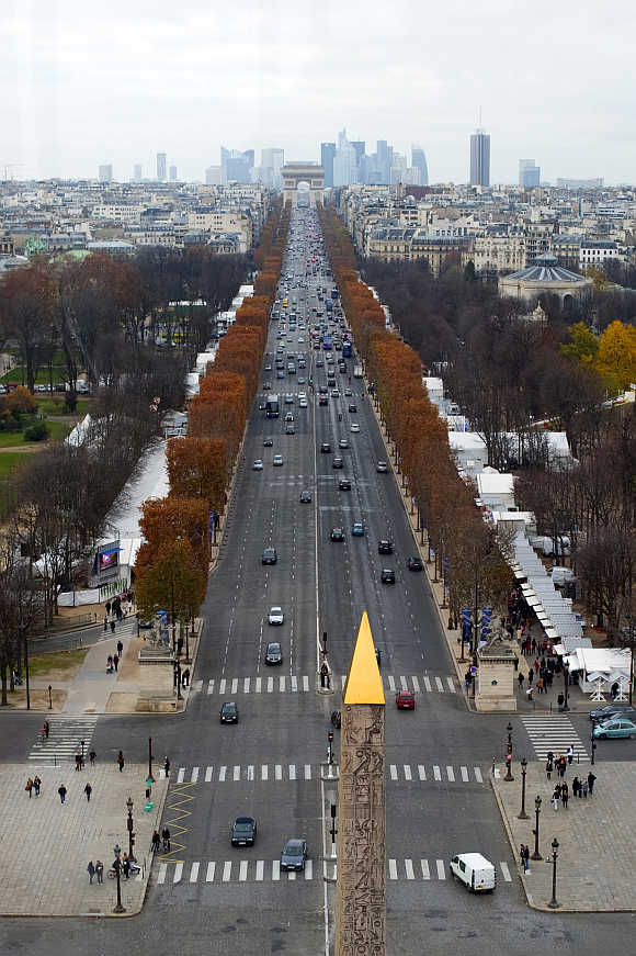 A view of the Concorde obelisk, Champs Elysees Avenue and the Arc de Triomphe monument in Paris.