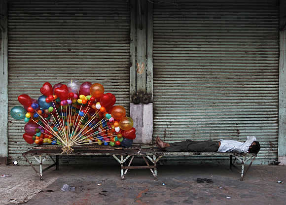 A balloon seller takes a nap in Delhi.