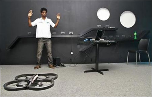 Vivek, an engineering student, demonstrates as he tries to control a Quad-copter with his hand at the Startup Village.
