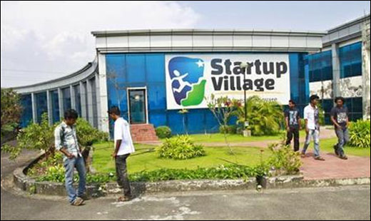 Employees stand outside the Startup Village.