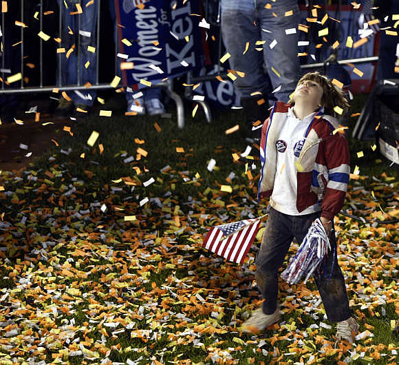 Eight-year-old Phoebe Moreo plays in the confetti spray in Dayton, Ohio.