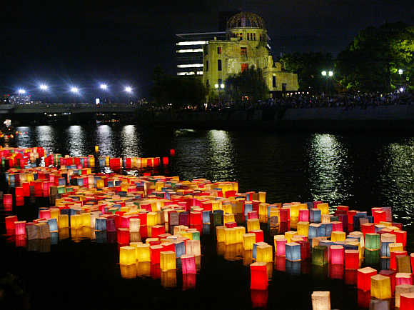 Paper lanterns symbolising vicitims of the 1945 atomic bombs float on a river in Hiroshima.