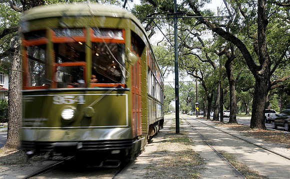 A Street Car travels down St Charles Avenue in New Orleans.