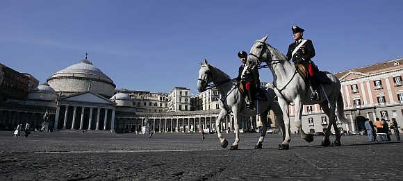 Italian Carabinieri patrol Plebiscito Square in Naples.
