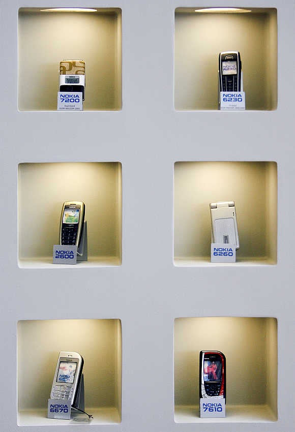 A selection of mobile phone models are displayed at Nokia's headquarters in Helsinki.
