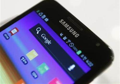 Samsung's logo is seen on a Galaxy smartphone displayed at the company's headquarters in Seoul