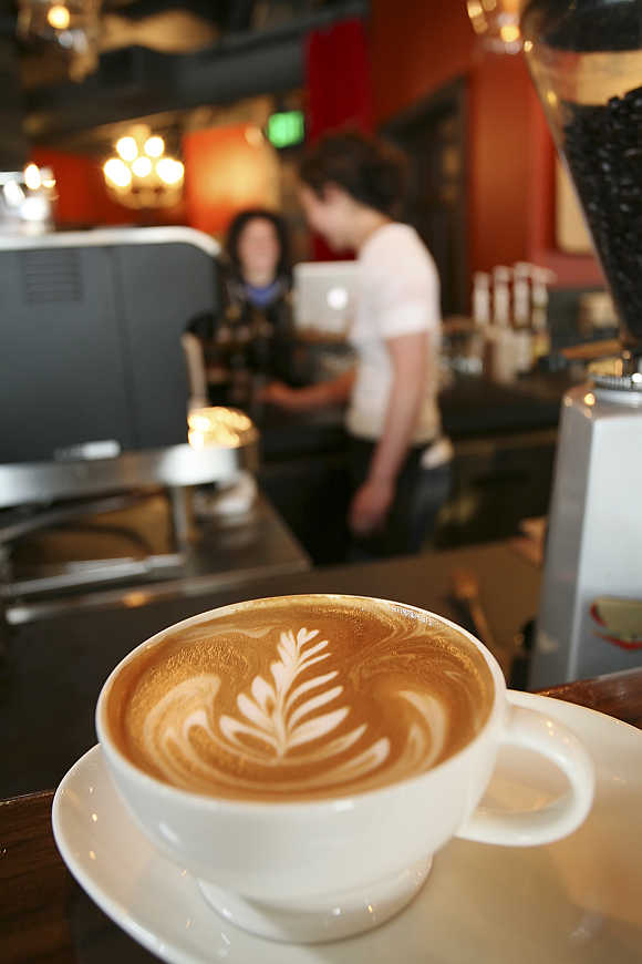 An artfully poured latte rests on the counter at Starbucks' Roy Street Coffee and Tea in Seattle, Washington.
