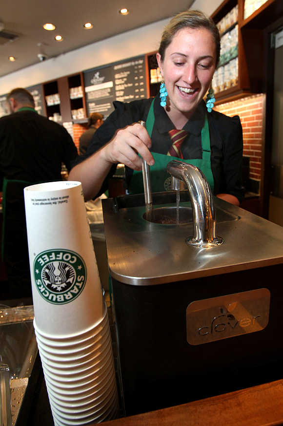 Starbucks barista Amy Hekinson makes a cup of Via instant coffee at the Queen Anne Hill Starbucks store in Seattle, Washington.