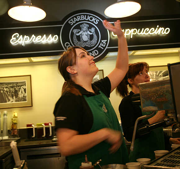 Robin takes an order at the first Starbucks store located at historic Pike Place Market in Seattle, Washington.