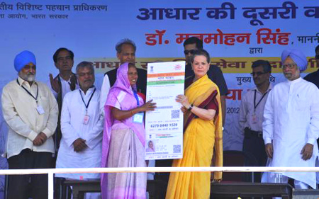 Sonia Gandhi issues the Aadhar card.