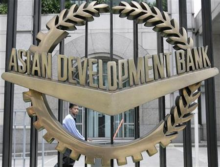 A worker walks past inside the Asian Development Bank (ADB) headquarters in Manila