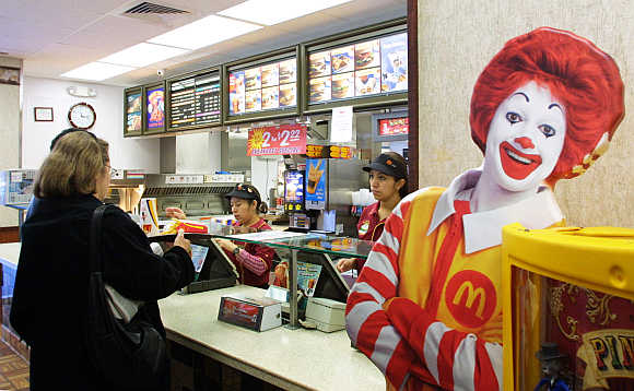 A patron picks up an order at a McDonald's restaurant in Washington.