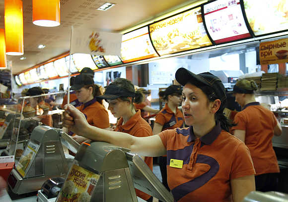 Service staff attend to customers at a McDonald's restaurant in Moscow.