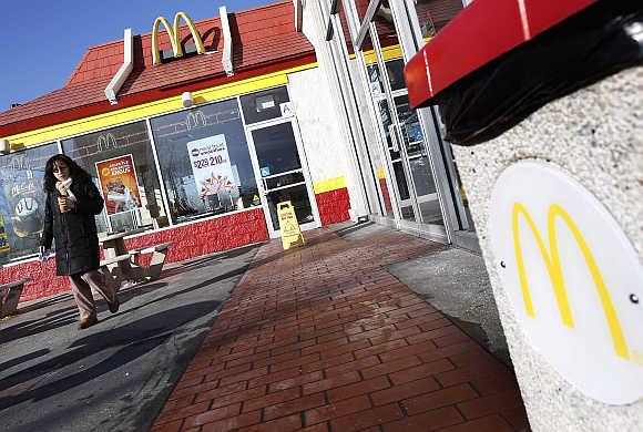 A woman walks out of a McDonald's restaurant in New York.