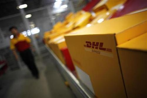 An employee is seen next to his workstation during an operational test of the new DHL North Asia Hub