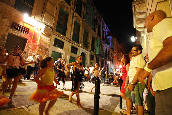 Dancers perform on a street during Notte Bianca (White Night) celebrations in Valletta.