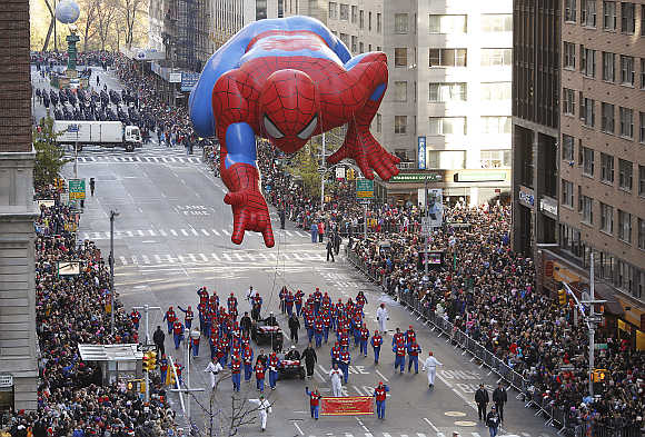 A Spiderman balloon float makes its way down Sixth Avenue during the Macy's Thanksgiving Day Parade in New York.