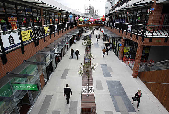Shoppers are seen at an outdoor mall in Melbourne.
