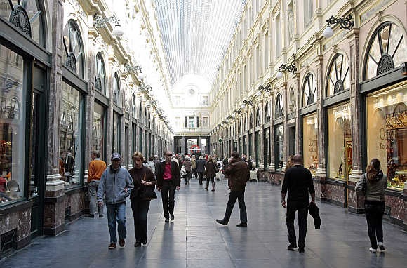 Tourists walk in Brussels' Royal Galleries of Saint Hubert.
