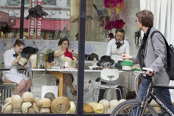 Hat designer Fiona Bennett and her assistants work in Bennett's studio at Potsdamer Street in Berlin.
