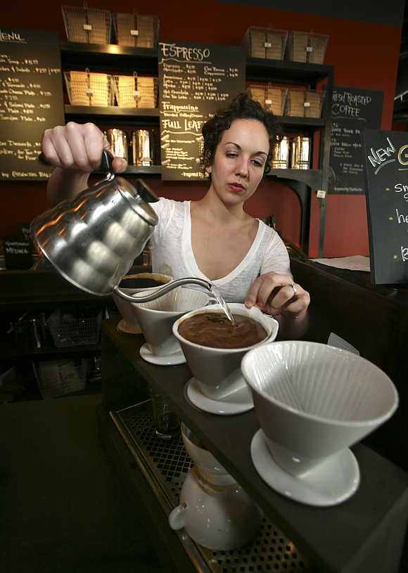 Vanessa Ament makes a cup of coffee at Starbucks in Seattle, Washington.