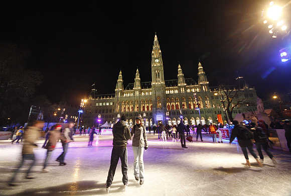 Skaters on an ice rink in Vienna.