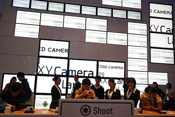 Visitors try out Samsung Electronics' Galaxy Camera in Seoul.